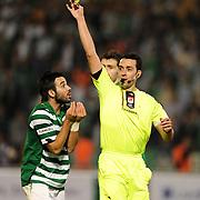 Referee's Abdullah YILMAZ show the yellow card to Bursaspor's Volkan SEN (L) during their Turkish soccer super league match Bursaspor between Kayserispor at Ataturk Stadium in Bursa Turkey on Saturday, 01 May 2010. Photo by TURKPIX