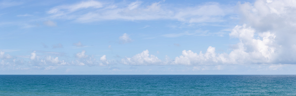 panoramic image of blue sky over a blue sea