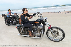 Kissa Von Addams riding on Daytona Beach during Daytona Bike Week 75th Anniversary event. FL, USA. Thursday March 3, 2016.  Photography ©2016 Michael Lichter.