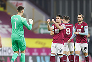 Burnley goalkeeper Nick Pope (1) and Burnley midfielder Ashley Westwood (18) fist pump during the Premier League match between Burnley and Aston Villa at Turf Moor, Burnley, England on 27 January 2021.