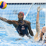 United States goalkeeper Ashleigh Johnson blocked a shot on goal in the USA's 12-5 gold medal victory over Italy on Friday at Olympic Aquatics Stadium during the 2016 Summer Olympics Games in Rio de Janeiro, Brazil.
