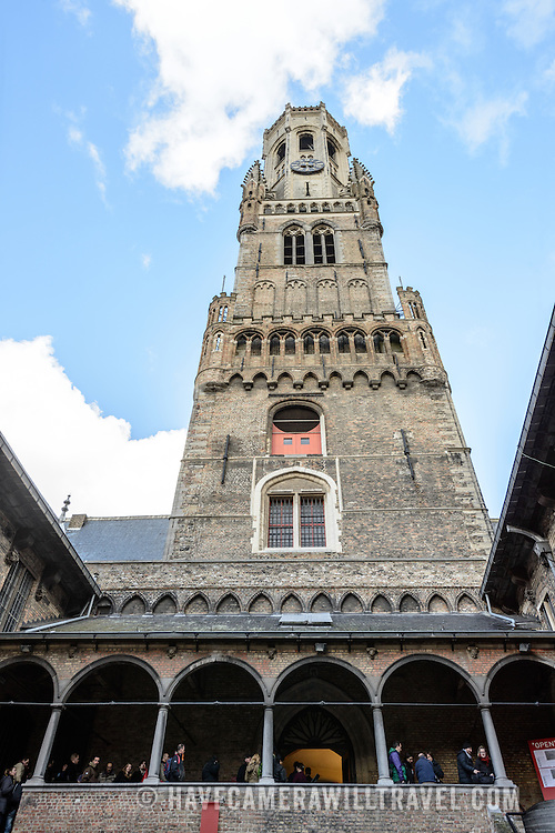 A view of the back of the Belfry of Bruges from the internal courtyard. The Belfry (or Belfort) is a medieval bell tower standing above the Markt in the historic center of Bruges. The first stage was built in 1240, with further stages on top built in the late 15th century.