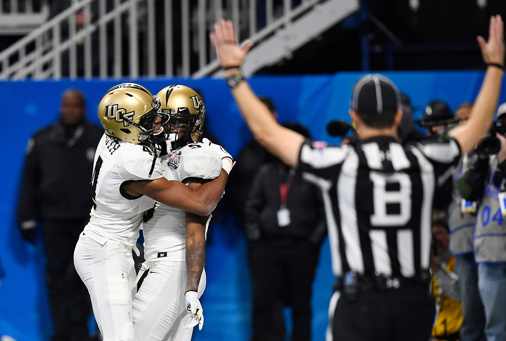 UCF Knights wide receiver Dredrick Snelson (5) celebrates his touchdown against Auburn University during the second half of the Chick-fil-A Peach Bowl NCAA college football game at the Mercedes-Benz Stadium in Atlanta, January 1, 2018. UCF won 34-27 to go undefeated for the season. (David Tulis via Abell Images for Chick-fil-A Peach Bowl)