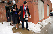 Democratic 2020 U.S. presidential candidate and entrepreneur Andrew Yang helps his wife Evelyn navigate an icy path after speaking at a town hall meeting in Sioux City, Iowa, January 27, 2020.     REUTERS/Rick Wilking