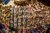 Handmade Venetian carnival masks on display at the shops of Ca' Macana, Venice, italy.