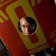 """DJ Lindsey Caldwell, who goes by """"DJ Lindsey,"""" is photographed with her turntables and part of her vinyl record collection at her home in Brooklyn on Nov. 21, 2007."""