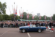 The newlyweds the Duke and Duchess of Cambridge drive down The Mall in a convertible Aston Martin following the reception in Buckingham Palace on the day of the royal wedding London, England, United Kingdom.
