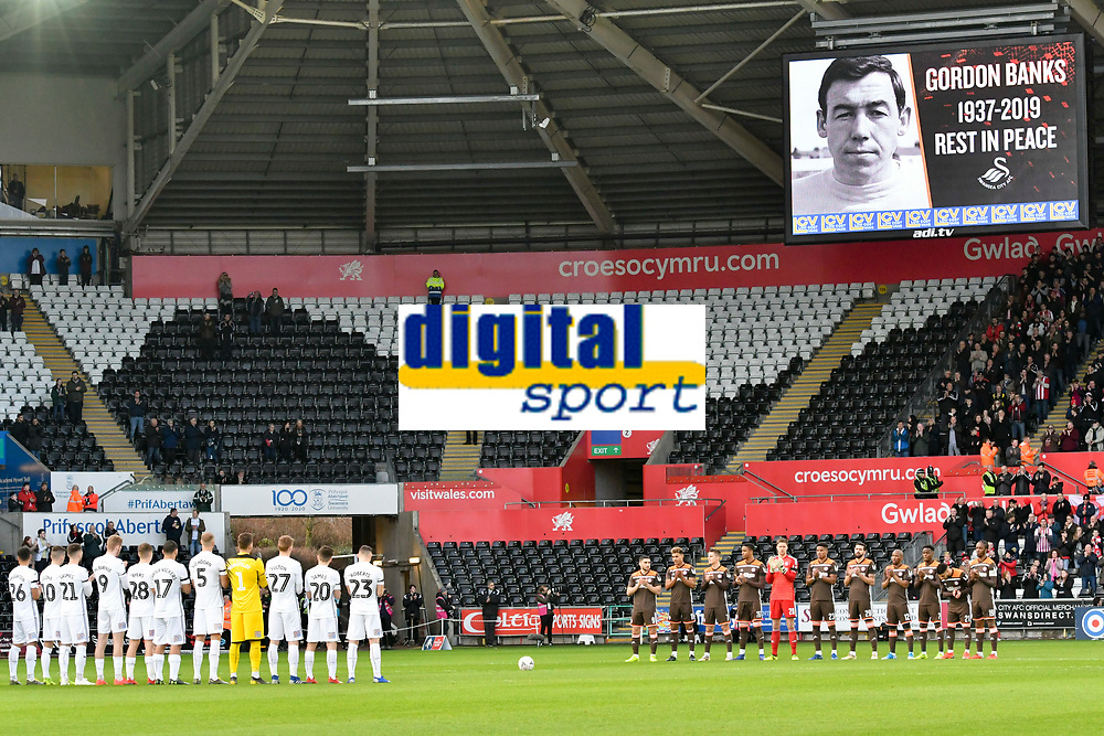 Football - 2018 / 2019 Emirates FA Cup - Fifth Round: Swansea City vs. Brentford<br /> <br /> both teams stand for a minutes applause in memory of gordon banks, at Liberty Stadium.<br /> <br /> COLORSPORT/WINSTON BYNORTH