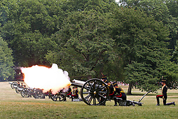 © Licensed to London News Pictures. 23/07/2013. London, UK. Gunners of the King's Troop Royal Artillery fire a 41 gun salute in Green Park, London, today (23/07/2013) to mark the birth of a new Royal Baby who was born yesterday to the Duke and Duchess of Cambridge at the Lindo Wing of St Mary's Hospital in Paddington, London. Photo credit: Matt Cetti-Roberts/LNP