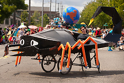 North America, United States, Washington, Seattle, globe and scorption floats in annual Summer Solstice Parade in Fremont neighborhood