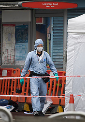© Licensed to London News Pictures. 07/07/2019. London, UK. Police forensics at the scene where a man in his 20s has been shot dead in Leyton, East London in the early hours of this morning. Photo credit: Ben Cawthra/LNP