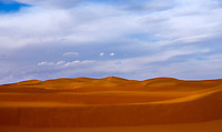 MERZOUGA, MOROCCO - CIRCA MAY 2018: Afternoon golden light  over the dunes of the Sahara Desert