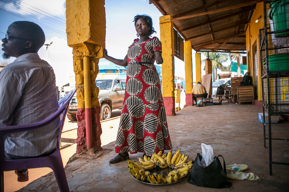 Margaret waits for customers to buy her bananas in downtown Gulu. She makes about 10,000 to 30,000 Uganda shillings a day (about three to six US dollars) depending on the weather.
