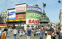 Statue of Eros, Piccadilly Circus, London, UK, favourite meeting place,  must see, tourists, young people, teenagers. 199808005.<br /> <br /> Copyright Image from Victor Patterson, Belfast, UK<br /> <br /> t: +44 28 9066 1296 (from Rep of Ireland 048 9066 1296)<br /> m: +44 7802 353836<br /> e: victorpattersonbelfast@gmail.com<br /> <br /> www.images4media.com<br /> <br /> Please see my full Terms and Conditions of Use at https://www.images4media.com/p/terms-conditions - it is IMPORTANT that you familiarise yourself with them.<br /> <br /> Images used online incur an additional cost. This cost should be agreed in writing in advance. Online images must be visibly watermarked i.e. © Victor Patterson or that of the named photographer within the body of the image. The original metadata must not be deleted from images used online.<br /> <br /> This image is only available for the use of the download recipient i.e. television station, newspaper, magazine, book publisher, etc, and must not be passed on to a third party. It is also downloaded on condition that each and every usage is notified within 7 days to victorpattersonbelfast@gmail.com.<br /> <br /> The right of Victor Patterson (or the named photographer) to be identified as the author is asserted in accordance with The Copyright Designs And Patents Act (1988). All moral rights are asserted.