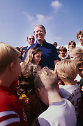 While driving in a motorcade to a vacation home in Georgia's Golden Isles, President Jimmy Carter saw children lining the roadway to get a peek at the president. Carter ordered the motorcade stopped and the children swarmed to him. - To license this image, click on the shopping cart below -