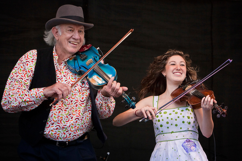 Cajun fiddler Hadley J. Castile and his granddaughter Sarah Jayde Williams of the Hadley J. Castille Family and The Sharecroppers Cajun Band performing on the Fais Do-Do Stage at the New Orleans Jazz and Heritage Festival at the New Orleans Fair Grounds Race Course in New Orleans, Louisiana, USA, 24 April 2009.