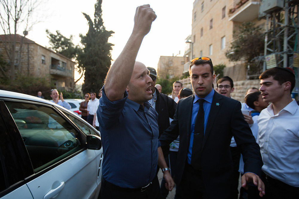 Naftali Bennett, leader of the Jewish Home party is seen as he waves for supporters after delivering a statement to the media outside a polling station in Jerusalem, Israel, on March 17, 2015, as Israelis vote in early parliament elections.
