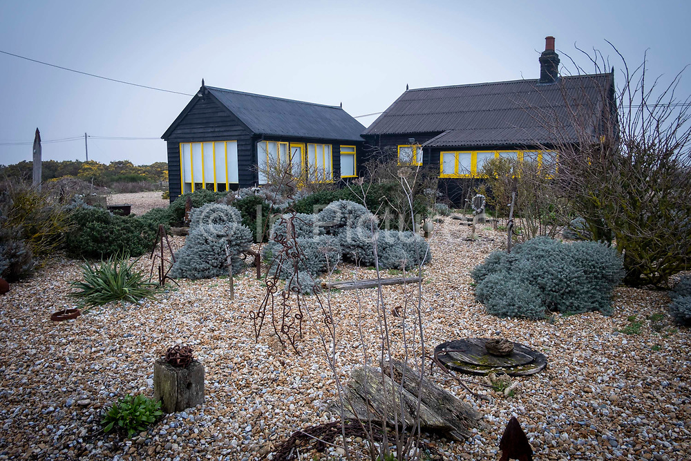 Prospect Cottage on a misty winters day, made famous by film maker Derek Jarman who found inspiration at Dungeness, where he created a shingle garden made from debris he found on the beaches of Dungeness, Kent, United Kingdom on the 25th January 2020.