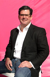 Dec 03 2007. New Orleans, Louisiana. Lower 9th Ward.<br /> Brad Pitt revisits the Lower 9th ward, devastated by Hurricane Katrina to present 'Make it Right' where architects' designs are unveiled to the public. One of the winning design Architects, Trey Trahan of Trahan Architects of Baton Rouge with a pink background for the pink project.<br /> Photo credit; Charlie Varley.