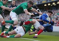 Ireland's Peter O'Mahony and Conor Murray tackle France's Romain Ntamack during the Guinness Six Nations match at the Aviva Stadium, Dublin.
