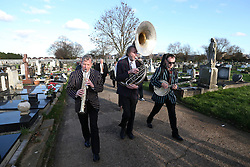 © Licensed to London News Pictures. 09/12/2015. London, UK. A brass band following The coffin being carried to a burial service.... The funeral of former brothel keeper Cynthia Payne takes place at the South London Crematorium.  In 1980 Cynthia Payne was sentenced to 18 months for running a brothel at her house on Ambleside Avenue in Streatham. It was alleged, at the time, that judges and Members of Parliament were visitors to her establishment. Photo credit: Peter Macdiarmid/LNP
