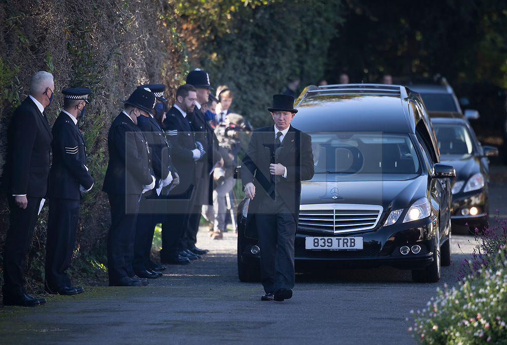 © Licensed to London News Pictures. 04/11/2020. Shoreham, UK. Police officers pay their respects (L) as the funeral cortege carrying the coffin of police Sgt Matt Ratana leaves a funeral directors in Shoreham, West Sussex after a service was held. Family members were joined by police colleagues including Metropolitan Police Commissioner Cressida Dick. A traditonal Maori Haka was performed during the service. Sgt Ratana died from a gunshot wound to the chest in the early hours of September 25 at Croydon custody centre. Photo credit: Peter Macdiarmid/LNP