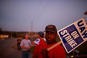 Workers from United Auto Workers Local 440 picket outside the General Motors Bedford Powertrain factory, where parts are molded from liquid metal, as the sun sets on day three of a nationwide worker strike against GM, Wednesday, September 18, 2019 in Bedford, Ind. The workers walked off the job at midnight on September 16th after their contract ran out, and are asking for better pay, affordable healthcare, that temp workers be made permanent, that jobs not be sent overseas, and that some factories, like the one in Lordtown, Ohio, be reopened. More than 700 workers at the Bedford, Indiana, factory are among the 49,000 workers nationally that are on strike.