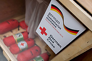 First Aid kits in amergency supplies warehouse, Deutsches Rotes Kreuz (DRK - German Red Cross) at their logistics centre at Berlin-Schönefeld airport. Ready for immediate loading into disaster zones, the equipment is stored near to where freight aircraft can fly anywhere in the world. The International Red Cross and Red Crescent Movement, with its 187 National Societies, is the world's largest humanitarian network. The German Red Cross is part of this universal community, which started 150 years ago to deliver comprehensive aid to people affected by conflict, disaster, sanitary emergencies, or social hardship, guided solely by their needs. Around four million volunteers and members support the Red Cross in Germany alone.