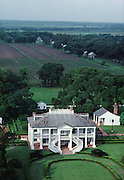 Ten-room slave-built Greek Revival mansion sat on a 2,500-acre Louisiana sugarcane plantation.  The double stairway faces towards the Mississippi River which sometimes served as an escape route for slaves.