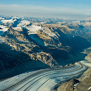 Iliamna Volcano and the Chigmit Mountains and icefields rise sharply above Lake Clark National Park, Alaska