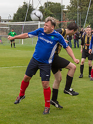 © Licensed to London News Pictures . 22/09/2013 . Lancing , UK . Shadow Chancellor ED BALLS heads the ball during the 2nd half of the Labour Party vs journalists football match . Day 1 of the Labour Party 's annual conference in Brighton . Photo credit : Joel Goodman/LNP