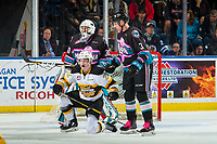 KELOWNA, CANADA - NOVEMBER 3:  Ben McCartney #22 of the Brandon Wheat Kings gets up off the ice after being checked by Dalton Gally #3 in front of the net of Roman Basran #30 of the Kelowna Rockets on November 3, 2018 at Prospera Place in Kelowna, British Columbia, Canada.  (Photo by Marissa Baecker/Shoot the Breeze)