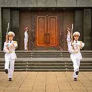 Soldiers complete the Changing of the Guard Ceremony outside the Ho Chi Minh Mausoleum. A large memorial in downtown Hanoi surrounded by Ba Dinh Square, the Ho Chi Minh Mausoleum houses the embalmed body of former Vietnamese leader and founding president Ho Chi Minh.