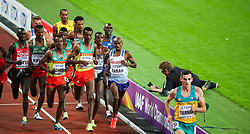 London, August 12 2017 . Muktar Edris, Ethiopia, Yomif Kejelcha, Ethiopia, and Mo Farah, Great Britain, chase down a surging Patrick Tiernan, Australia, in the men's 5000m final on day nine of the IAAF London 2017 world Championships at the London Stadium. © Paul Davey.