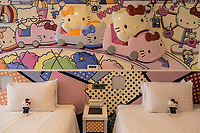 """Keio Plaza Princess Kitty Room<br /> Keio Plaza Hotel Hello Kitty Rooms - here guests will find that there are two Hello Kitty theme rooms,  The most outlandish of which is the Princess Kitty room, which has been deemed """"adorable"""" is its own Hello Kitty resort for adults.  The decor is all pink, of course, including bedding, headboards, sofas and chairs.  Think Pink!  Rest your weary bones on the pink high heel chair and feel like a fairy tale princess.  Even the amenities are Kitty themed, all the way down to bathroom scales, pens, letter writing sets and even plastic bags.   They even offer special room service meals with kitty shaped burgers, omelet's imprinted with kitty's mug just in case you were to ever forget where you are staying…  There other room is the Kitty Town Room which is more tuned to kids, with more primary colors and less pink."""