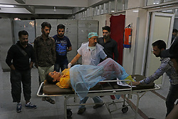 September 7, 2017 - India - People carry an injured woman for treatment at a local hospital..One civilian was killed and 13 others including a traffic policeman were injured when suspected militants lobbed a grenade towards paramilitary CRPF vehicle at Jehangir Chowk in Srinagar. (Credit Image: © Umer Asif/Pacific Press via ZUMA Wire)