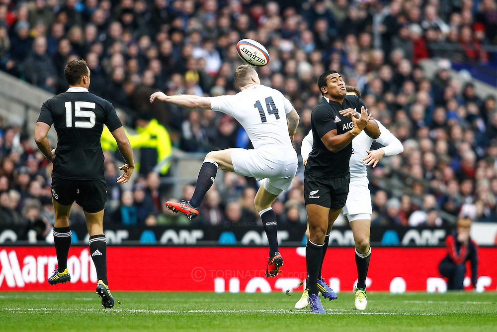 Picture by Andrew Tobin/SLIK images +44 7710 761829. 2nd December 2012. Chris Ashton and Julian Savea challenge for a high ball during the QBE Internationals match between England and the New Zealand All Blacks at Twickenham Stadium, London, England. England won the game 38-21.