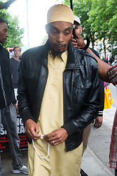 """July 29, 2017 - London, London, UK - London, ESA CHARLES takes part in a demonstration organised by Stand Up To Racism outside Stoke Newington Police station following the death of his son Rashan Charles whilst being arrested by police. A statement from Scotland Yard said Mr Charles went into a shop, where he was seen """"trying to swallow an object"""" and it was then police officers struggled with him to make an arrest. (Credit Image: © Ray Tang/London News Pictures via ZUMA Wire)"""