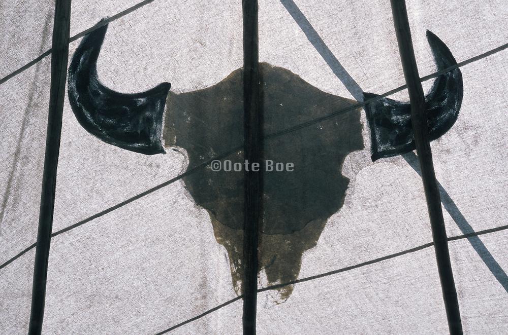 painted buffalo on fabric