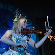 VENICE, ITALY - MARCH 05:  A violinist performs at Palazzo Pisani Moretta during the annual Ballo del Doge on March 5, 2011 in Venice, Italy. The Ballo del Doge, created by fashion and costume designer Antonia Sautter, is considered the most elegant and exclusive masquerade ball during the Venice Carnival.