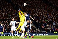 Scotland forward Steven Fletcher (9) (Sheffield Wednesday) challengers goalkeeper Ariel Harush (1) (Hapoel Be'er Sheva)of Israel for the high ball during the UEFA Nations League match between Scotland and Israel at Hampden Park, Glasgow, United Kingdom on 20 November 2018.