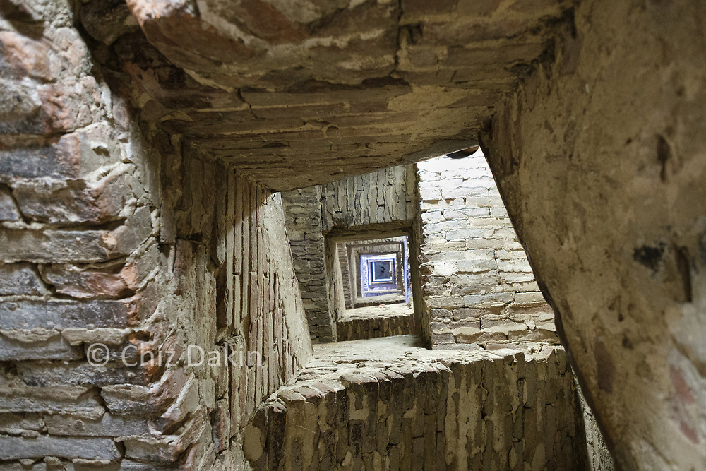 Siena - looking up the middle of the stone staircase of the Torre del Mangia