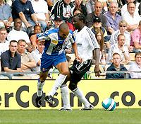 Photo: Steve Bond.<br />Derby County v RCD Espanyol. Pre Season Friendly. 04/08/2007. Valdo (L) skips over Mo Camera's challange (R)