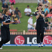 New Zealand captain Haidee Tiffen (right) celebrates another Australian wicket during the Australia V New Zealand group A match at North Sydney Oval in the ICC Women's World Cup Cricket Tournament, in Sydney, Australia on March 8, 2009. New Zealand beat Australia by 13 runs in the (D/L method)  rain affected match. Photo Tim Clayton