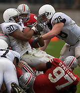 MORNING JOURNAL/DAVID RICHARD.Penn  State fullback BranDon Snow, #30, is stopped by the Buckeyes' defense on a third-down-and-one play in the third quarter.