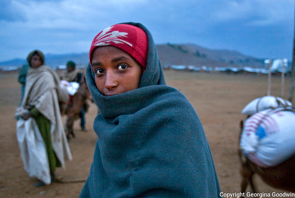 A yound girl is the last to receive USAID food aid in Washera, 13 hours north of Addis Adaba in Ethiopia, during the 2009 drought which many feared would lead to another famine. July 2009
