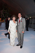 JOAN COLLINS; PERCY GIBSON, CARTIER CHELSEA FLOWER SHOW DINNER Dinner hosted by Cartier in celebration of the Chelsea Flower Show was held at Battersea Power Station. 22 May 2012
