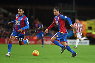 Marouane Chamakh of Crystal Palace ® makes a break. Barclays Premier league match, Stoke city v Crystal Palace at the Britannia Stadium in Stoke on Trent, Staffs on Saturday 19th December 2015.<br /> pic by Andrew Orchard, Andrew Orchard sports photography.