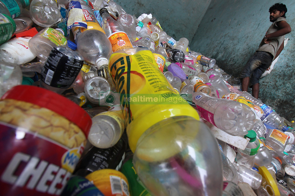 March 23, 2019 - Mumbai, India - An Indian man stands on recyclable plastic bottles made from PET (polyethylene terephthalate) plastic at a plastic recycling centre in Mumbai, India on 23 March 2019. (Credit Image: © Himanshu Bhatt/NurPhoto via ZUMA Press)