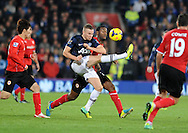 Tom Cleverley of Manchester United beats the challenge of Cardiff City's Jordon Mutch.<br /> Barclays Premier League match, Cardiff city v Manchester Utd at the Cardiff city stadium in Cardiff, South Wales on Sunday 24th Nov 2013. pic by Phil Rees, Andrew Orchard sports photography,